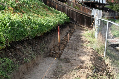 how to build a wood retaining wall on a slope