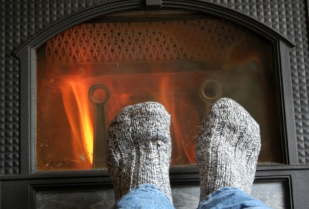 Warming feet in front of fire